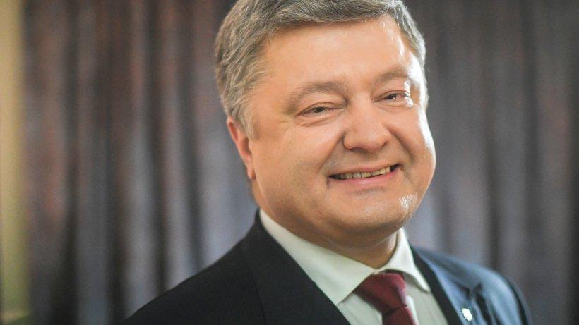"""Порошенко заявил о своем """"большом желании"""" отмены антироссийских санкций"""